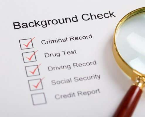 magnifying glass over background check form