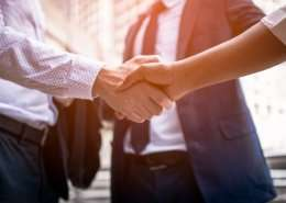 businessman shaking hands with background screening provider