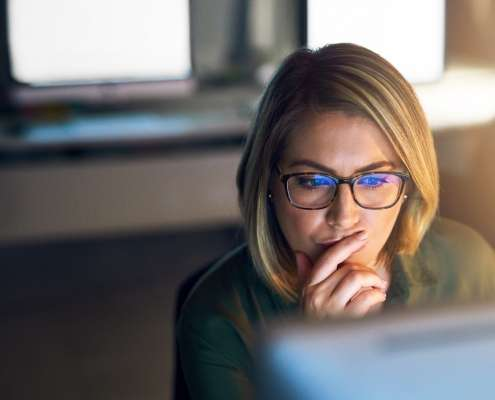 businesswoman conducting employee background screening re-checks