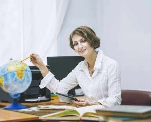 teacher in school at desk
