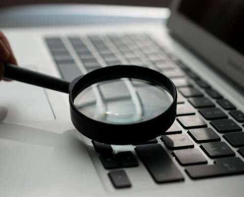 running a personal background check on laptop