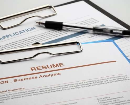 picture of a resume and job application that will undergo education verification by a background check provider