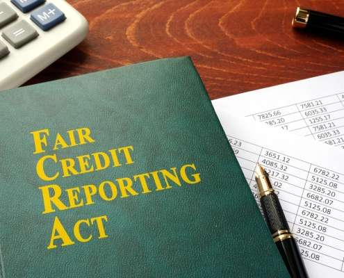 Fair Credit Reporting Act on a messy desk