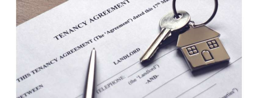signing a tenancy agreement to receive keys to house