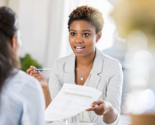 Young woman interviewing with company who has to make hiring decisions