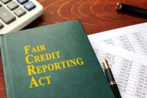 FCRA Fair Credit Reporting Act on a table.