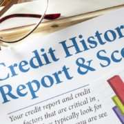 Credit Reports and Score with chart and glasses on desk