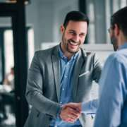 background check provider shaking hands at interview