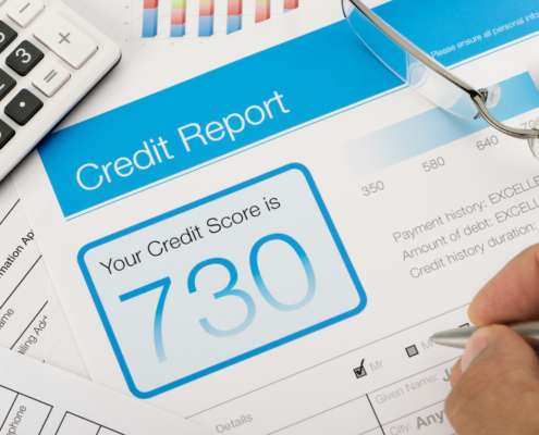 Credit reports with score on a desk