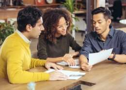 professional tenants signing rental agreement with landlord