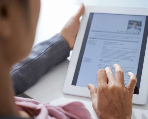 An HR representative using a tablet for an integrated background check.