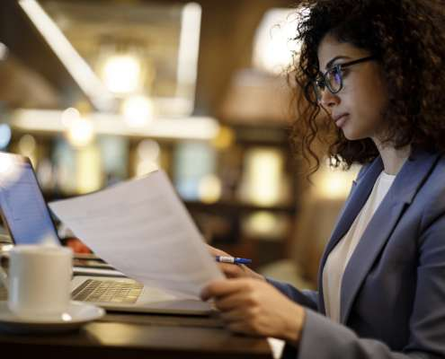 A businesswoman checking references as a part of employment verification